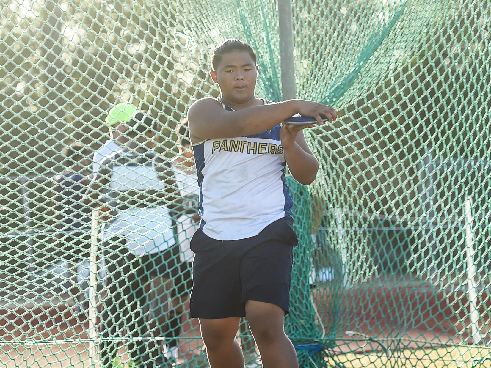 Guam High's Matua Whalen, 15, winds up for his throw in the Discus 1.6kg Varsity during a IIAAG Track and Field meet at John F. Kennedy Ramsey Field in Tamuning on May 10, 2019.