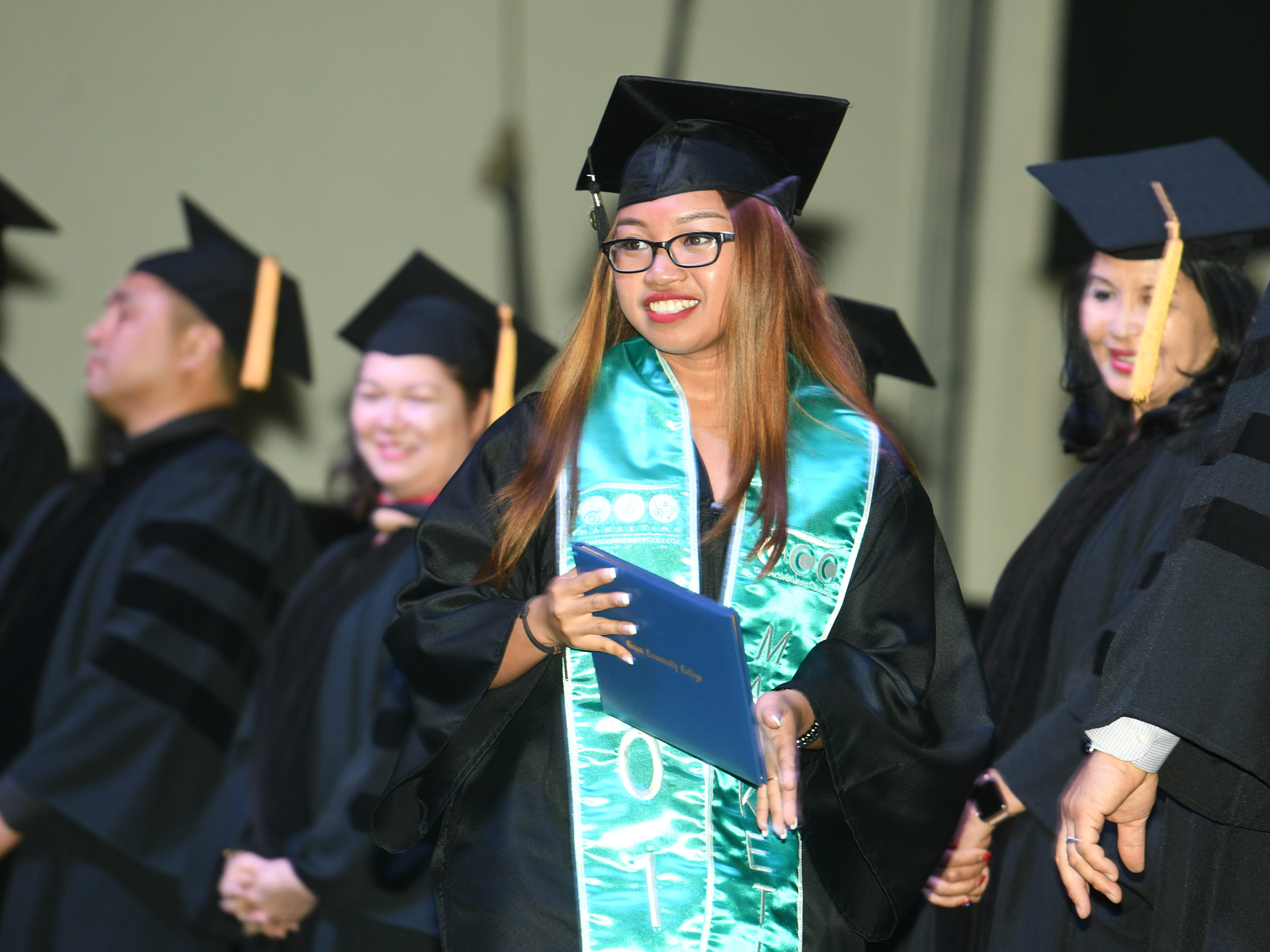 A graduate celebrates a little after receiving her certification or diploma during the Guam Community College's 2019 commencement exercise at the University of Guam in Mangilao on Friday, May 10, 2019. The college conferred a total of 435 degrees, certificates, and/or diplomas to 357 graduates at the event attended by hundreds of family members, friends and other well wishers.
