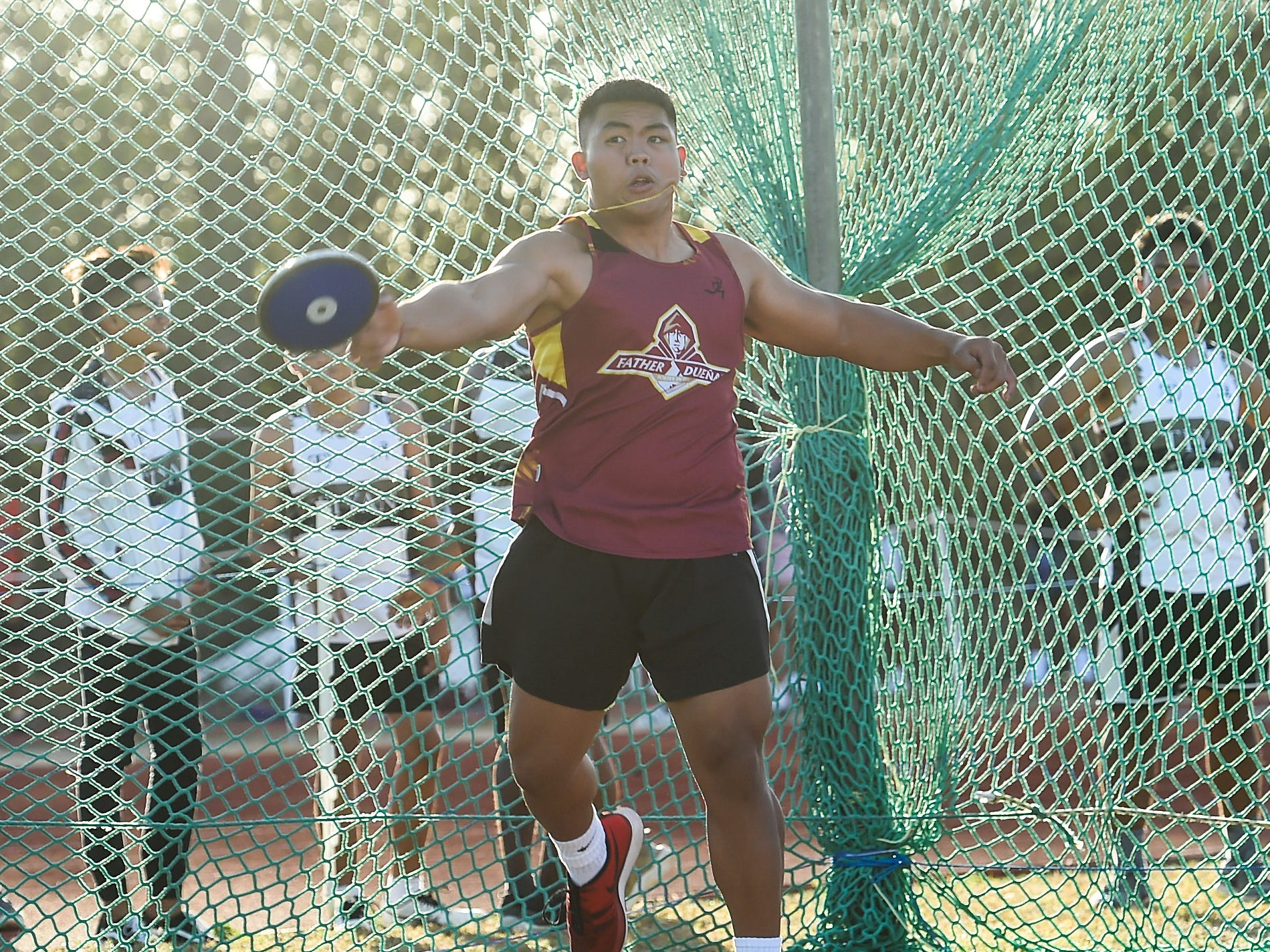 Father Duenas' Kevin Agarpao, 17, competes in the Discus 1.6kg Varsity during a IIAAG Track and Field meet at John F. Kennedy Ramsey Field in Tamuning on May 10, 2019.