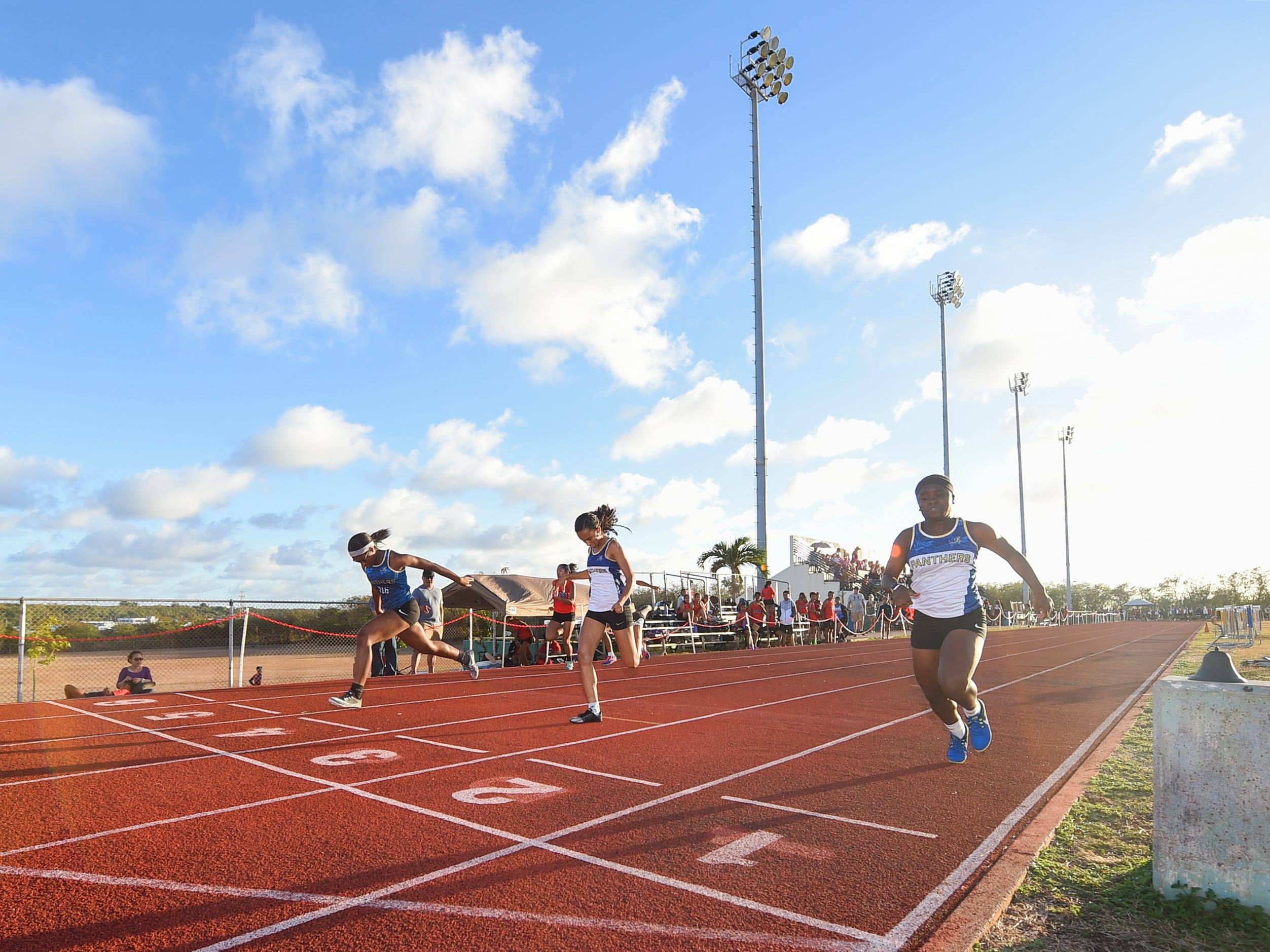Track and field athletes compete for their schools during a IIAAG Track and Field meet at John F. Kennedy Ramsey Field in Tamuning on May 10, 2019.