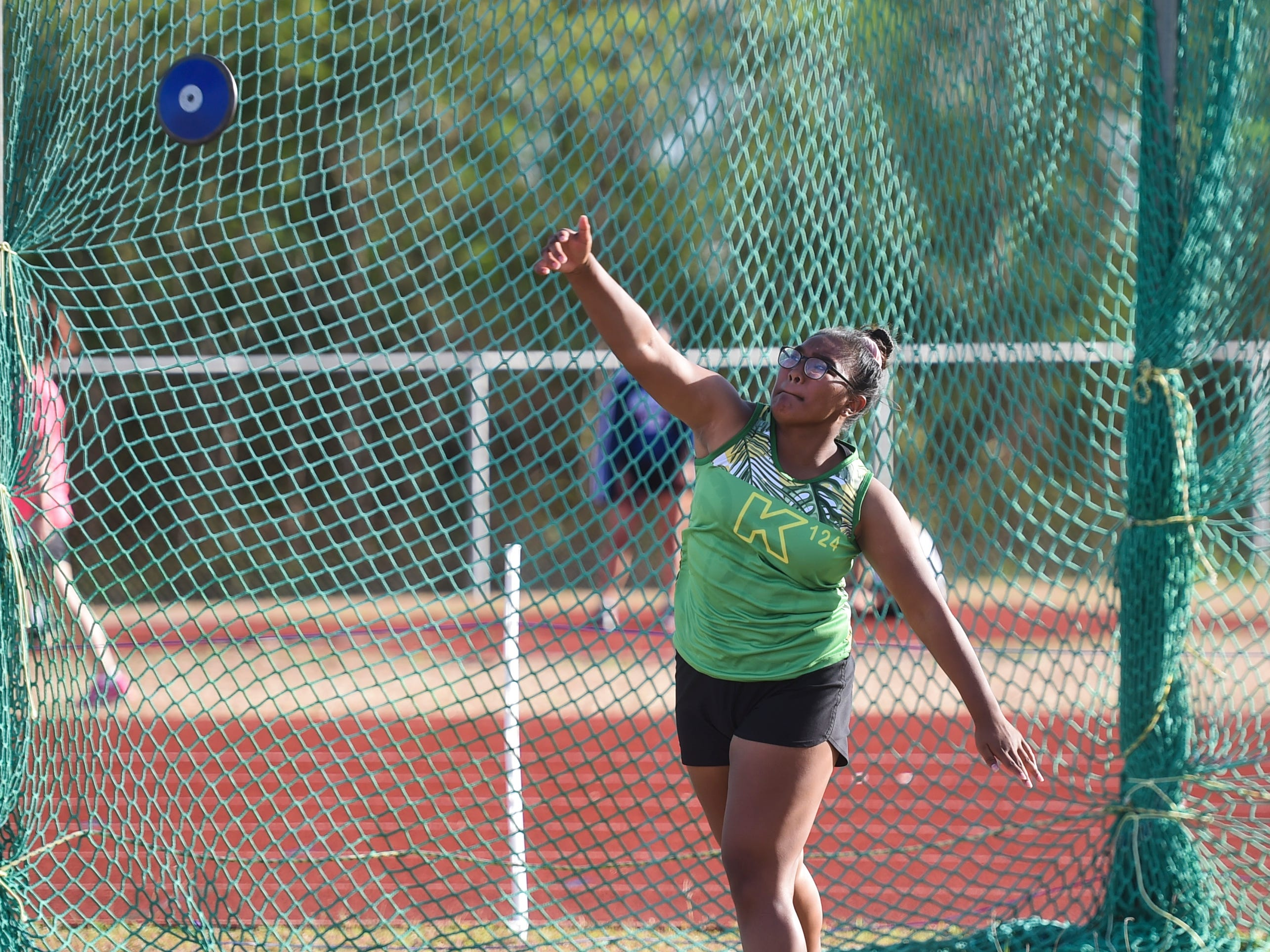 John F. Kennedy's Loryn Techaira, 16, competes in the 1kg Discus Varsity during a IIAAG Track and Field meet at John F. Kennedy Ramsey Field in Tamuning on May 10, 2019.