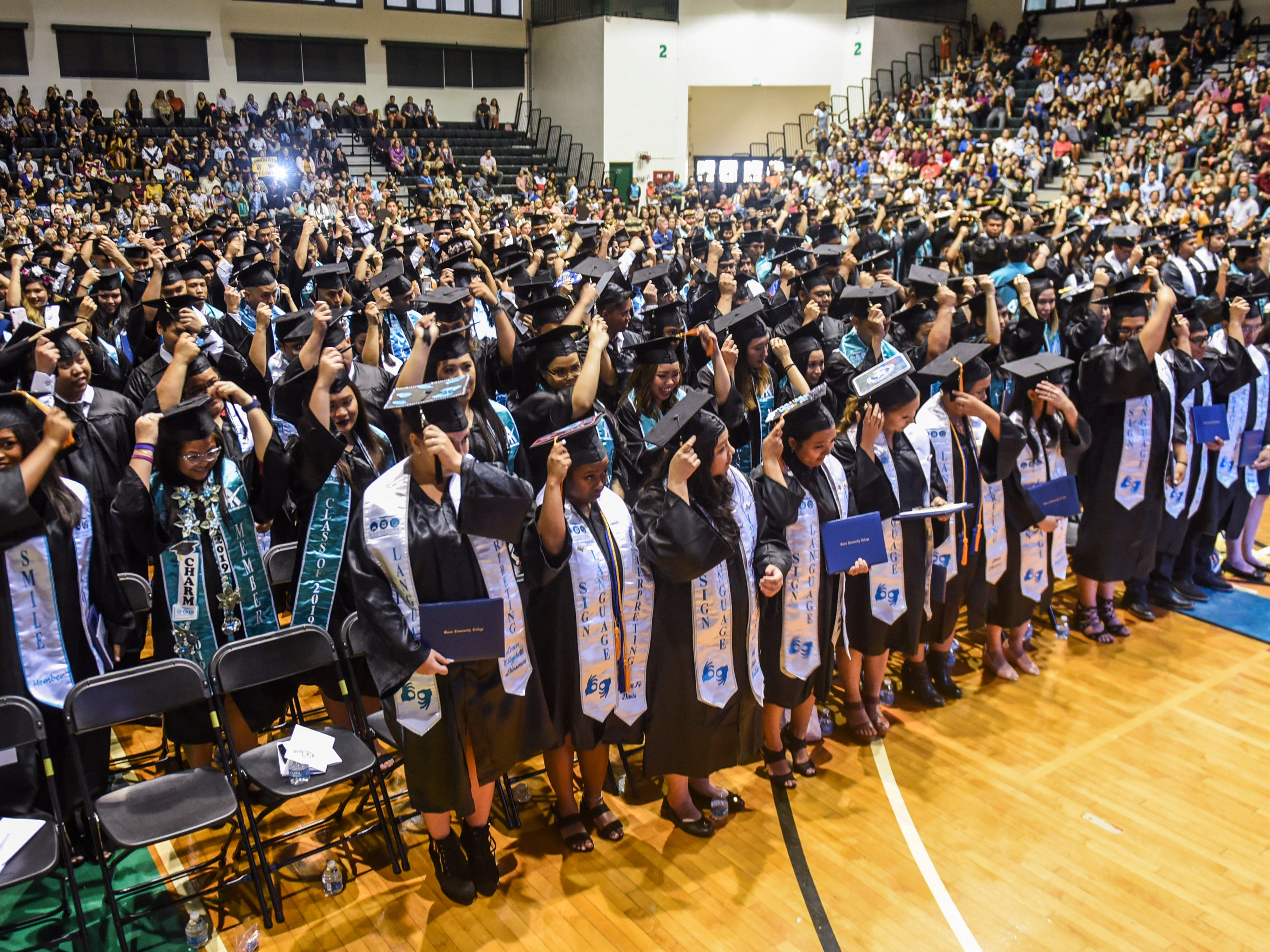 The traditional turning of the tassel is undertaken 357 graduates during Guam Community College's commencement exercise at the University of Guam in Mangilao on Friday, May 10, 2019. The institution conferred a total of 435 degrees, certificates, and/or diplomas to the graduates at the ceremony, attended by hundreds of family members, friends and other well wishers.