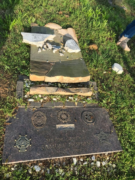 The vandalized tombstone and marker of Henderson founder Gen. Samuel Hopkins.