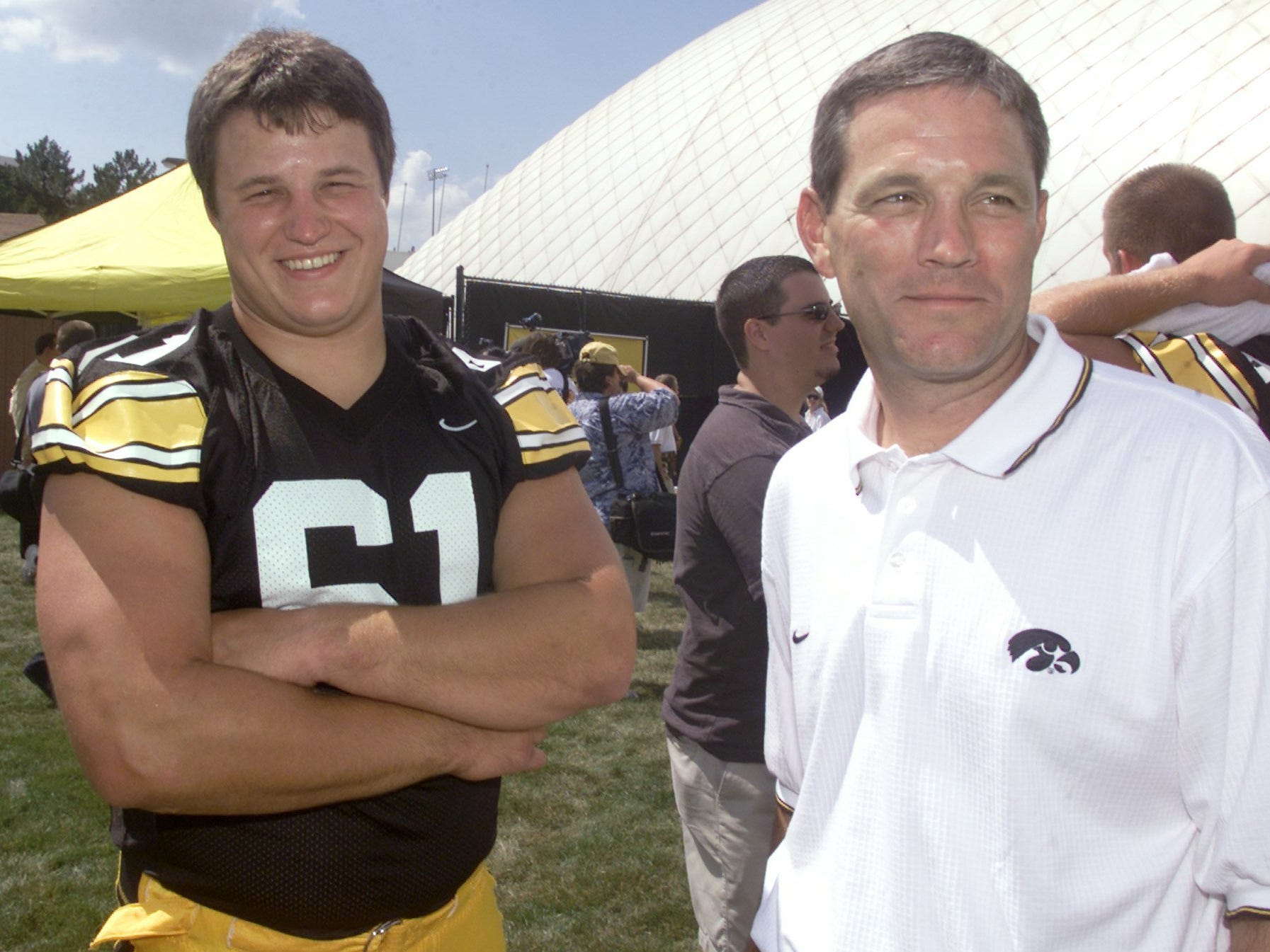 From 2003: Iowa offensive lineman Brian Ferentz laughs with his father, Iowa head coach Kirk Ferentz, during the team's media day Aug. 7, 2003, in Iowa City.