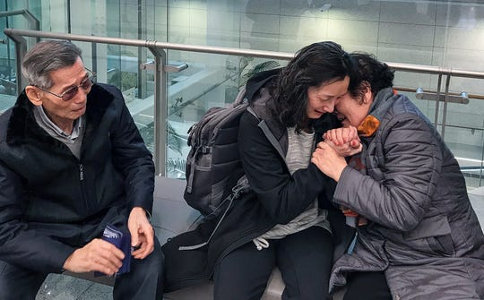 Kim Gantt is reunited with her birth parents at the airport in Seoul, South Korea on March 11, 2019.