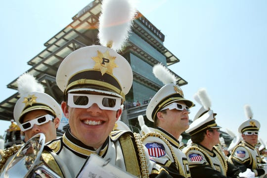Fans, including Purdue musician Doug Booth, wear special sunglasses made in honor of Dan Wheldon before the 96th running of the Indy 500 at the Indianapolis Motor Speedway, Sunday, May 27, 2012.   A special tribute was given to the late race car driver.