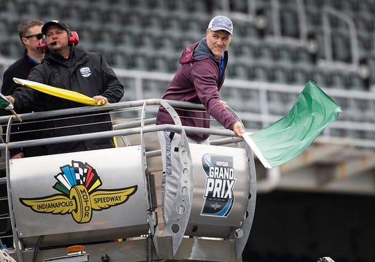 Colts kicker Adam Vinatieri waves the green flag to start the USF2000 race Friday, May 10, 2019 at IMS. Vinatieri is a co-owner of a race team in the USF2000 series.