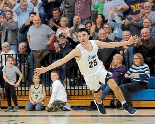 Butler, Pa.'s Ethan Morton, ranked among the top 75 juniors nationally, celebrates after beating McDowell High School during their game, Dec. 14, 2018.