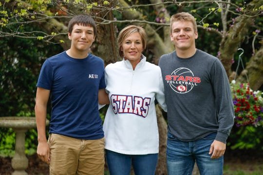 IndyStar Sports Mom of the Year, Angela Young, is shown here at her Thorntown Ind., home with her two sons, Peyton, right, a three sport athlete who was on the state championship football team last fall at Western Boone; and Elliott, left, who is also a three-sport athlete at Western Boone; on Friday, May 10, 2019.