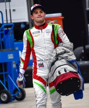 Carlin driver Patricio O'Ward (31) walks to his pit box practice for the IndyCar Grand Prix  on Friday, May 9, 2019.