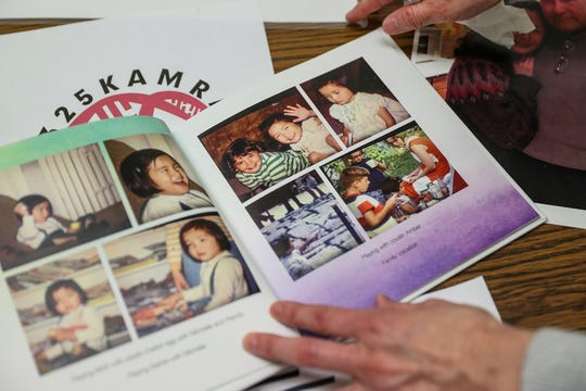 Childhood photos of Kim Gantt are seen in a photo album, Thursday, May 9, 2019. Gantt gave a copy of the album to her Korean birth parents who she recently reunited with fifty years after her adoption.