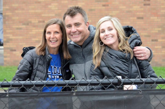 Erin Russell (right), her husband Brian (middle) and Lynette Tynan, vice president of Booster Club (left) at a recent Unified Track meet, where they were working concessions.