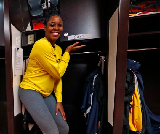 Bria Goss shows her temporary signage for her locker in the Indiana Fever locker room, Friday May 10, 2019, at Bankers Life Fieldhouse. The 2011 Indiana Miss Basketball, when at Ben Davis High School, went on to play basketball at the University of Kentucky, then professionally in Finland and Israel before being invited to play at the Indiana Fever training camp.