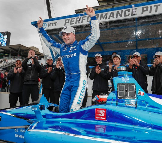 Chip Ganassi Racing driver Felix Rosenqvist (10) celebrates after winning the pole position for the IndyCar Grand Prix on Friday, May 9, 2019.