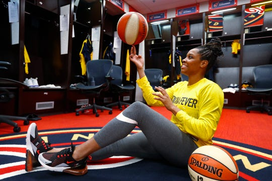 Bria Goss spins a basketball in the Indiana Fever locker room, Friday May 10, 2019, at Bankers Life Fieldhouse. The 2011 Indiana Miss Basketball, when at Ben Davis High School, went on to play basketball at the University of Kentucky, then professionally in Finland and Israel before being invited to play at the Indiana Fever training camp.