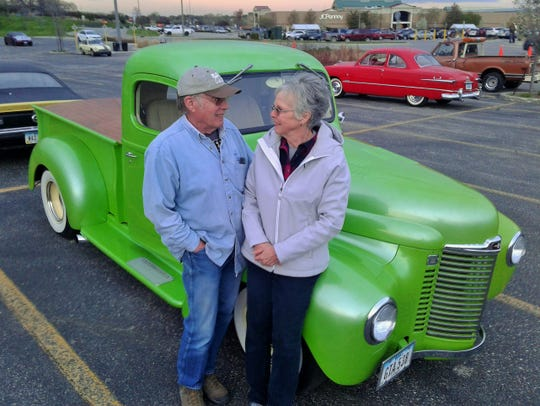 """Bob Reese and his wife Cathy enjoy this restored 1949 International pickup which once belonged to her grandfather. The color is """"Granny Smith Apple Green."""""""