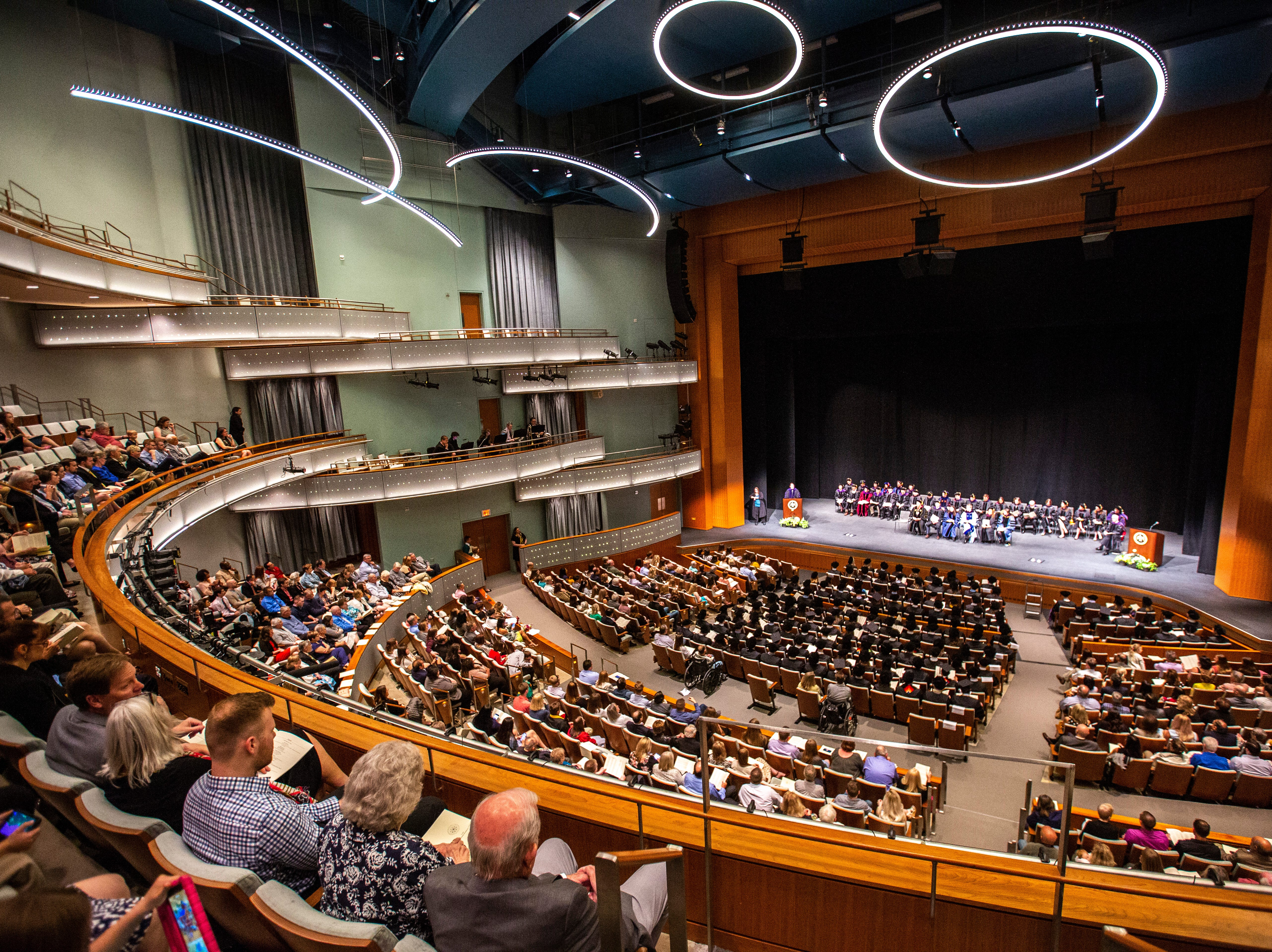 Friends and family gather during the College of Law commencement ceremony, Friday, May 10, 2019, at Hancher Auditorium on the University of Iowa campus in Iowa City, Iowa.