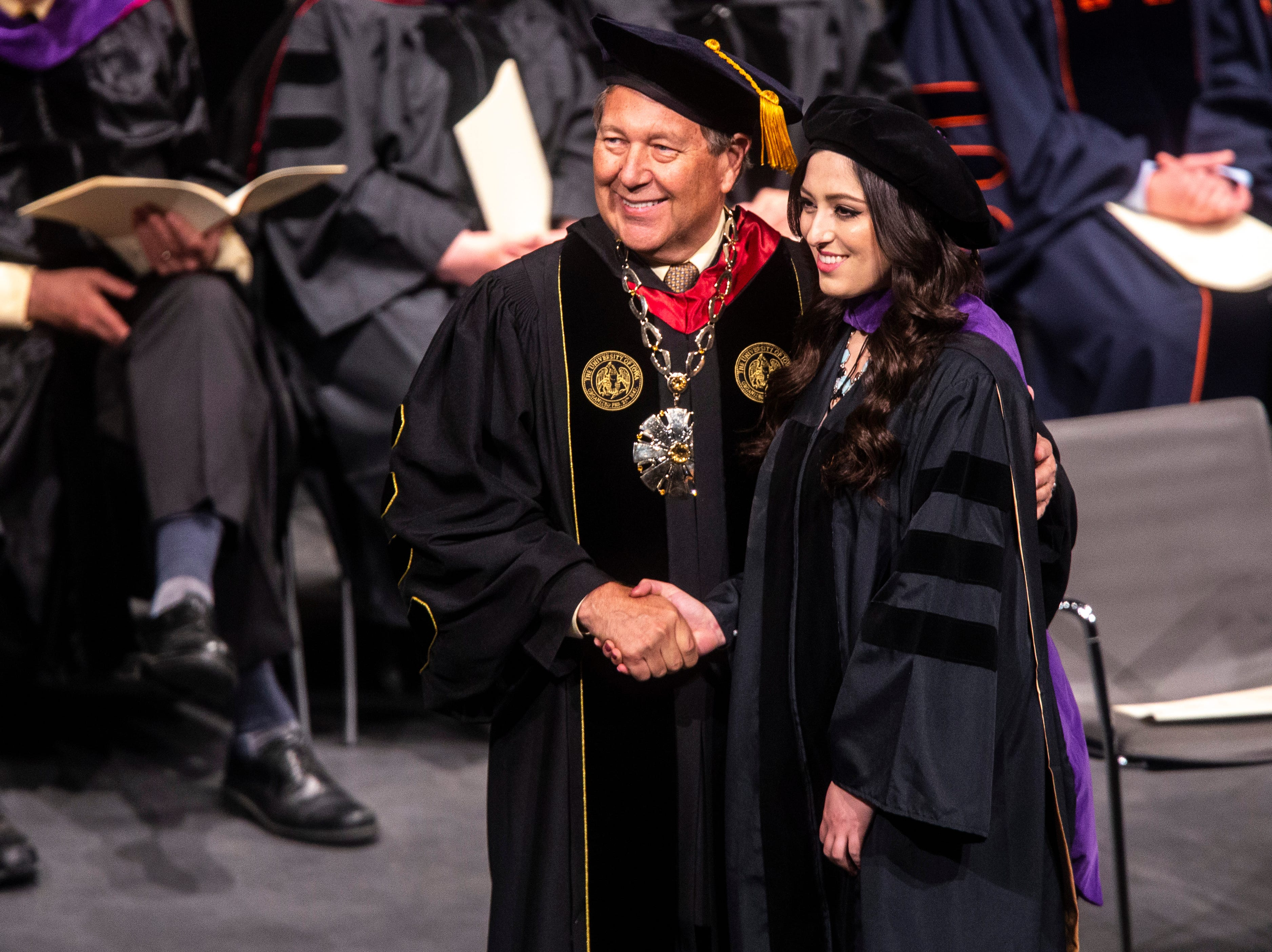 University of Iowa President J. Bruce Harreld poses for a photo with a recent graduate during the College of Law commencement ceremony, Friday, May 10, 2019, at Hancher Auditorium on the University of Iowa campus in Iowa City, Iowa.