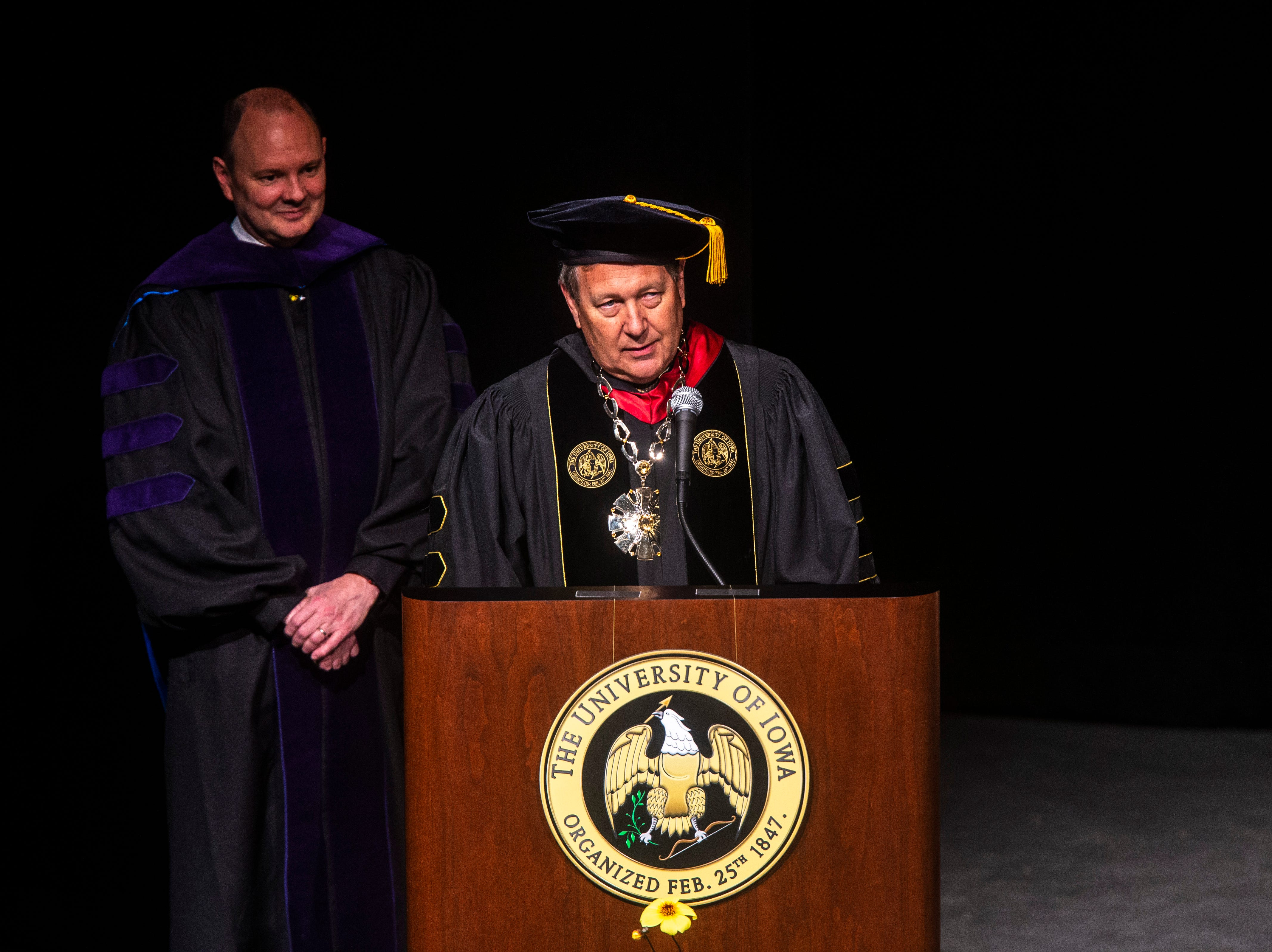 University of Iowa President J. Bruce Harreld speaks during the College of Law commencement ceremony, Friday, May 10, 2019, at Hancher Auditorium on the University of Iowa campus in Iowa City, Iowa. Kevin K. Washburn, N. William Hines Dean and Professor of Law, at left.