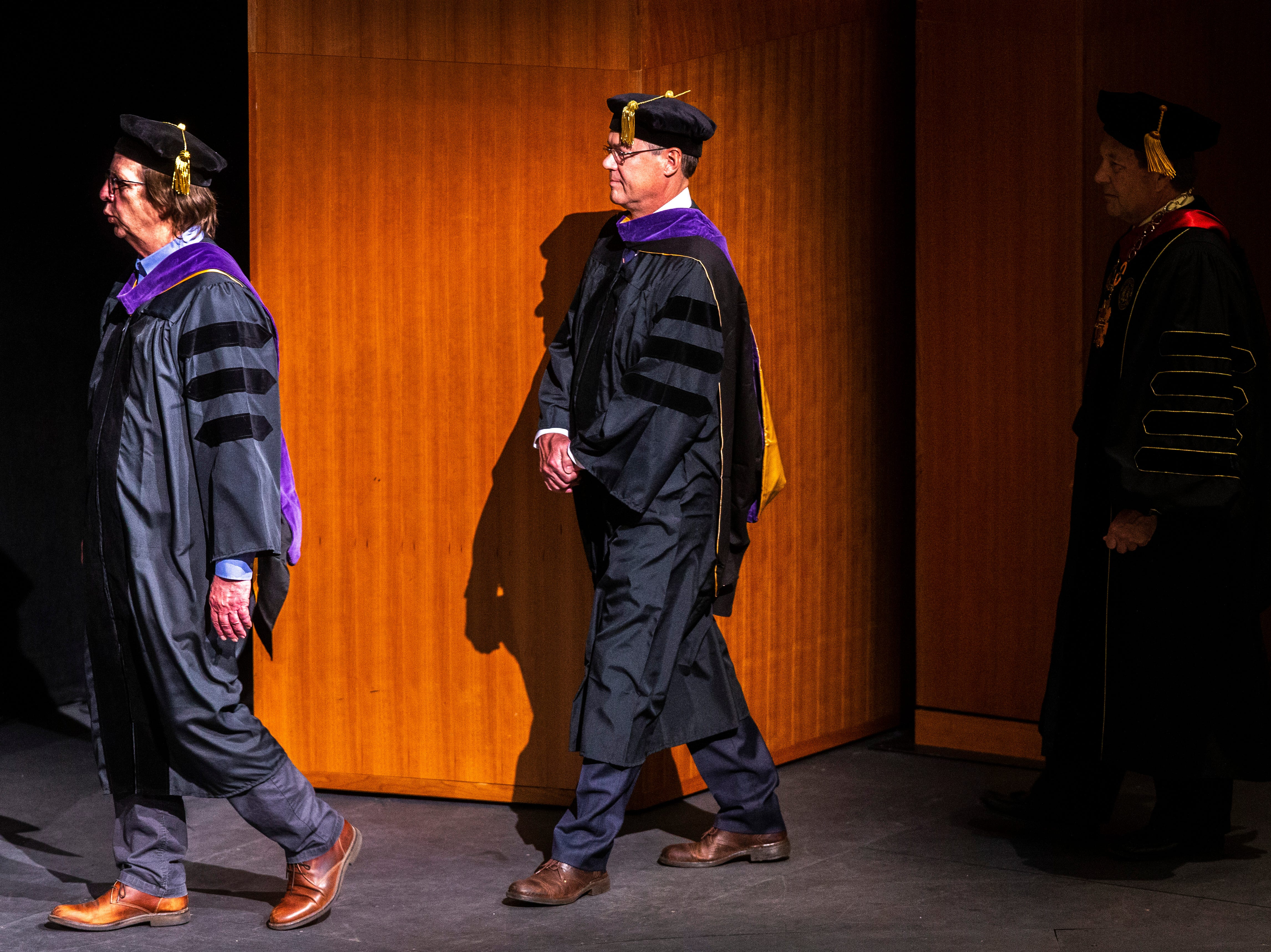 Joel H. Bolger, the Alaska Supreme Court Chief Justice and 1978 University of Iowa Law School graduate, center, walks on stage during the College of Law commencement ceremony, Friday, May 10, 2019, at Hancher Auditorium on the University of Iowa campus in Iowa City, Iowa.