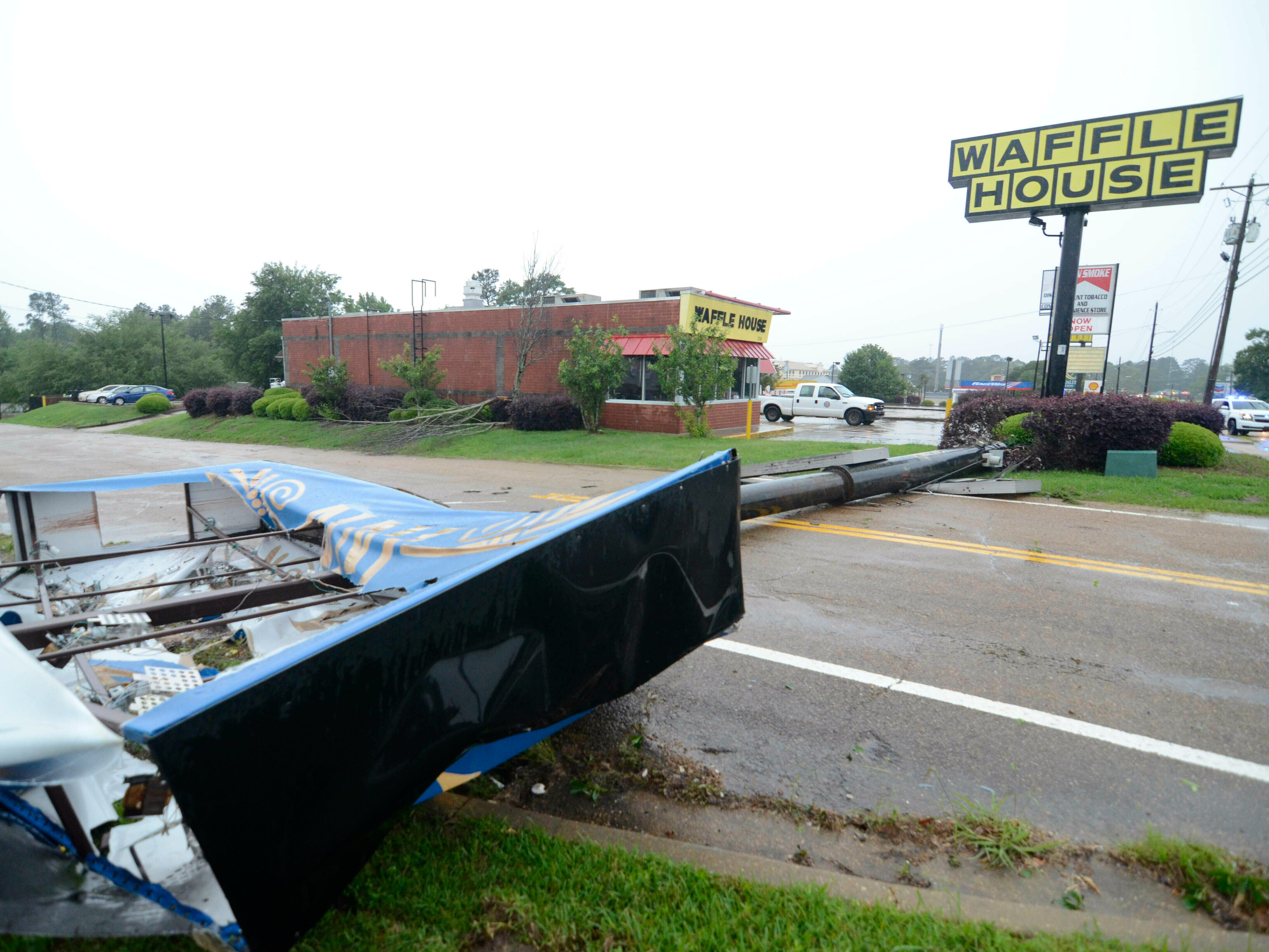 The sign for the Executive Inn lies across Commerce Street in McComb after a powerful storm blew through McComb, Miss., just before noon on Thursday, May 9, 2019.