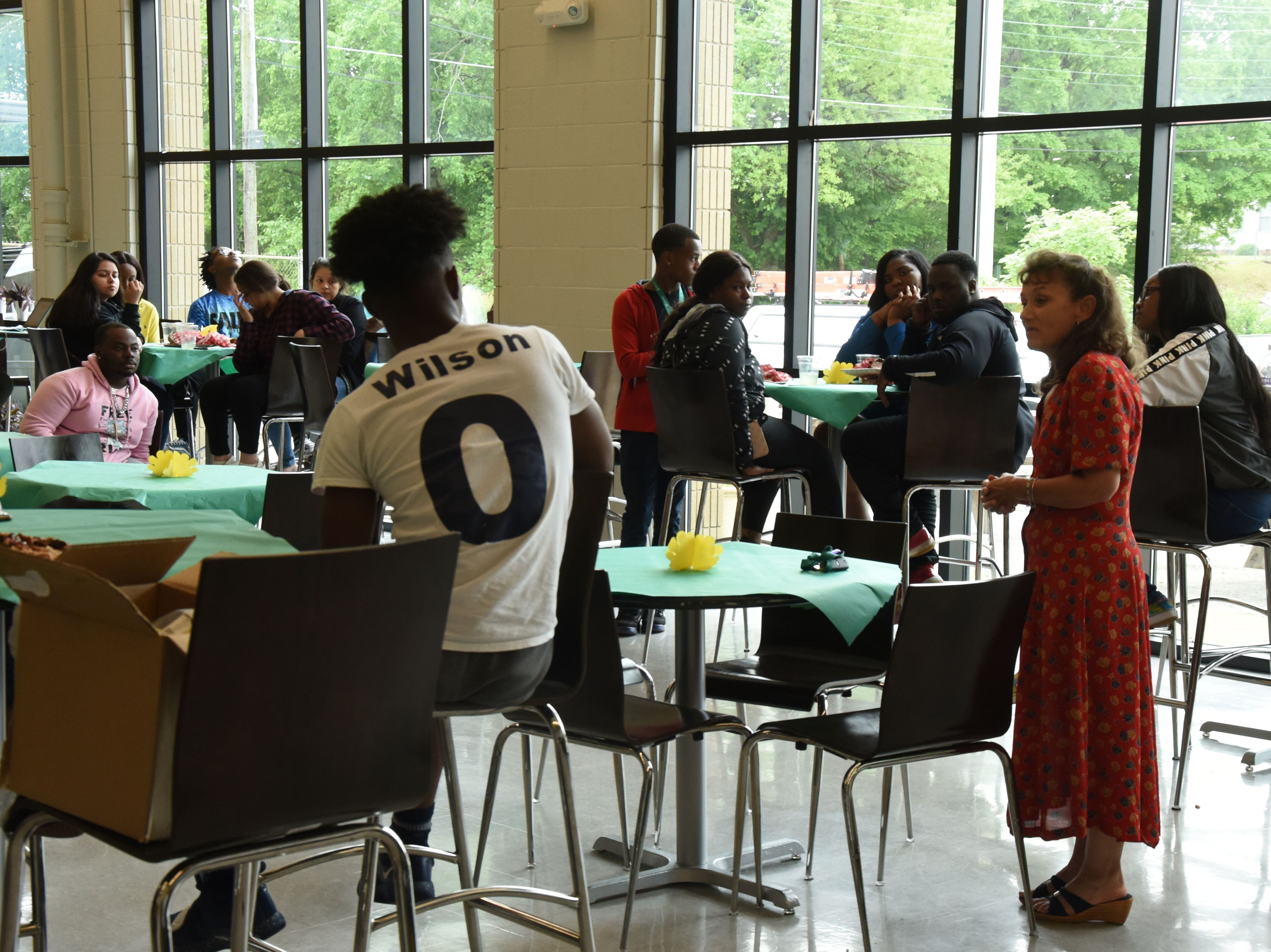Jackson State Community College president Dr. Allana Hamilton talks with Jackson-Central Merry Early College High School's first graduating class to earn associate's degrees.