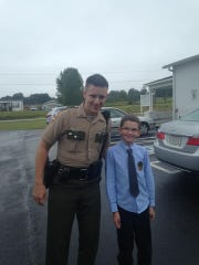 Tennessee Highway Patrol Trooper Matthew Gatti stands with Justin Aldridge at the Gospel Light Baptist Church's Home Town Hero Day in 2018. Gatti's parents say this picture captures Matthew's dedication to his job and love for people.