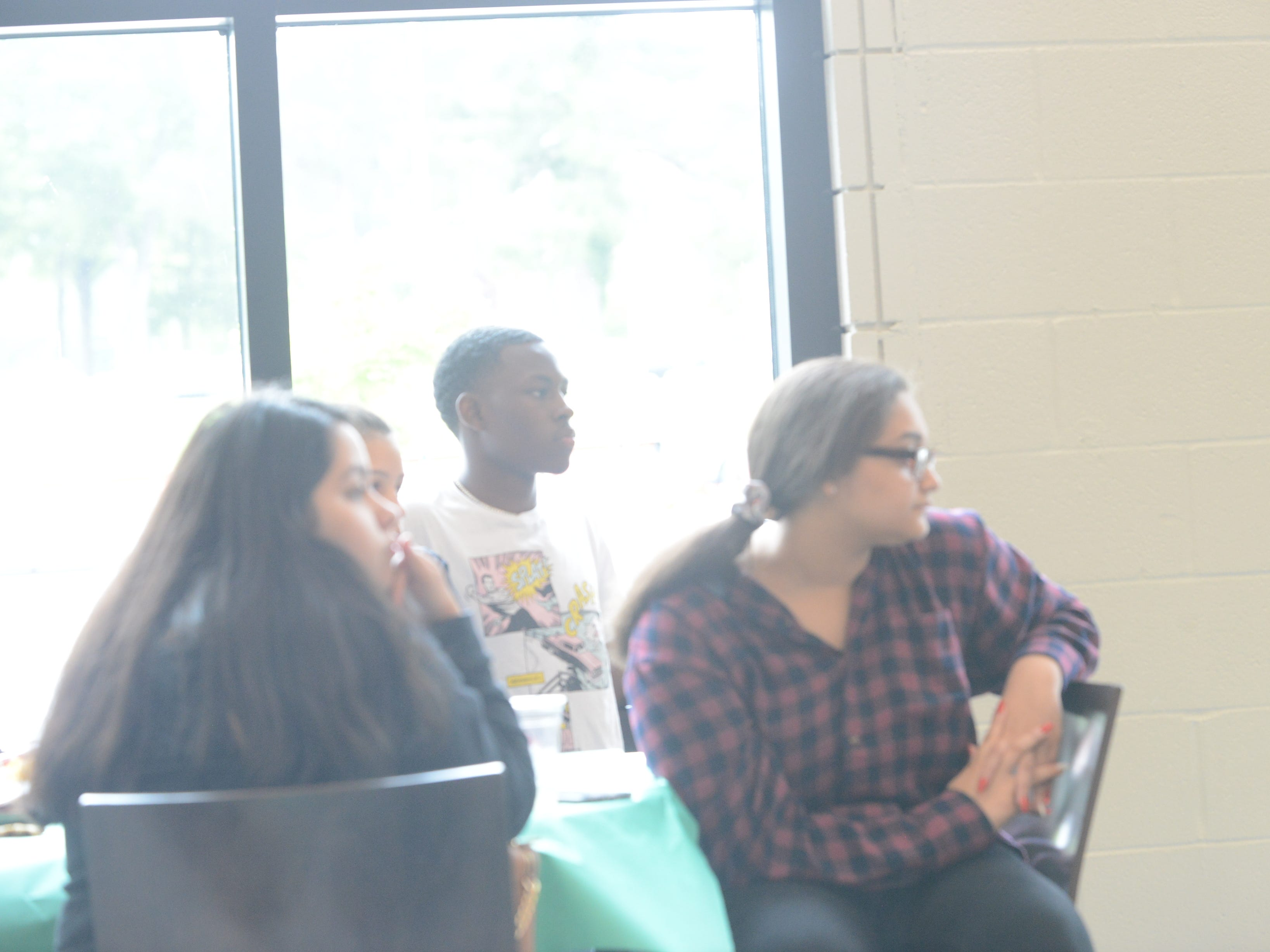 JCM-ECH seniors and JSCC students listen at their senior picnic as JSCC president Dr. Allana Hamilton gives them tips for the future.