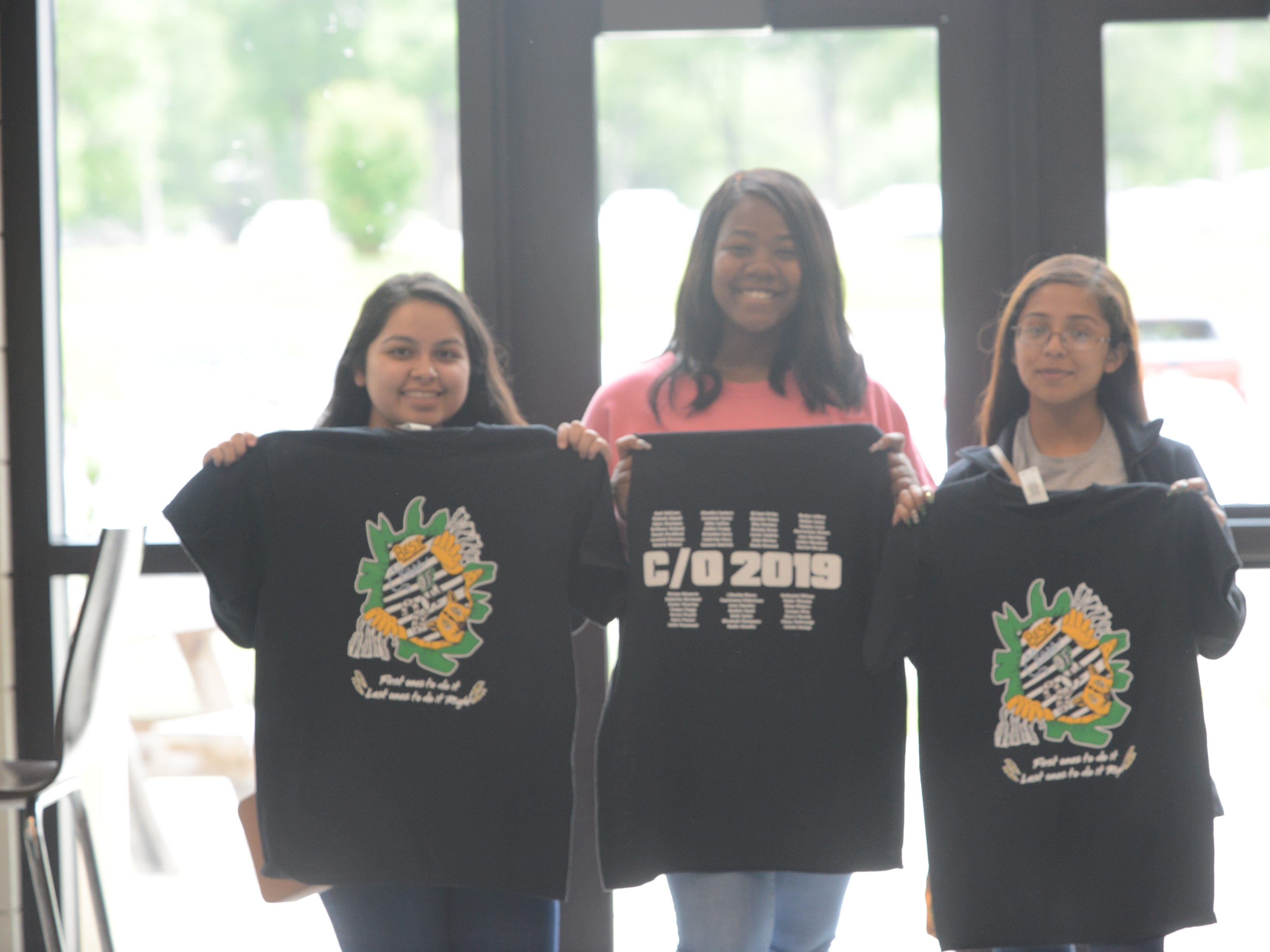 Students pose proudly with their senior shirts at the senior picnic.