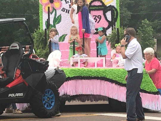 Young pageant winners ride on a float during the 2019 West Tennessee Strawberry Festival Parade on May 10, 2019.