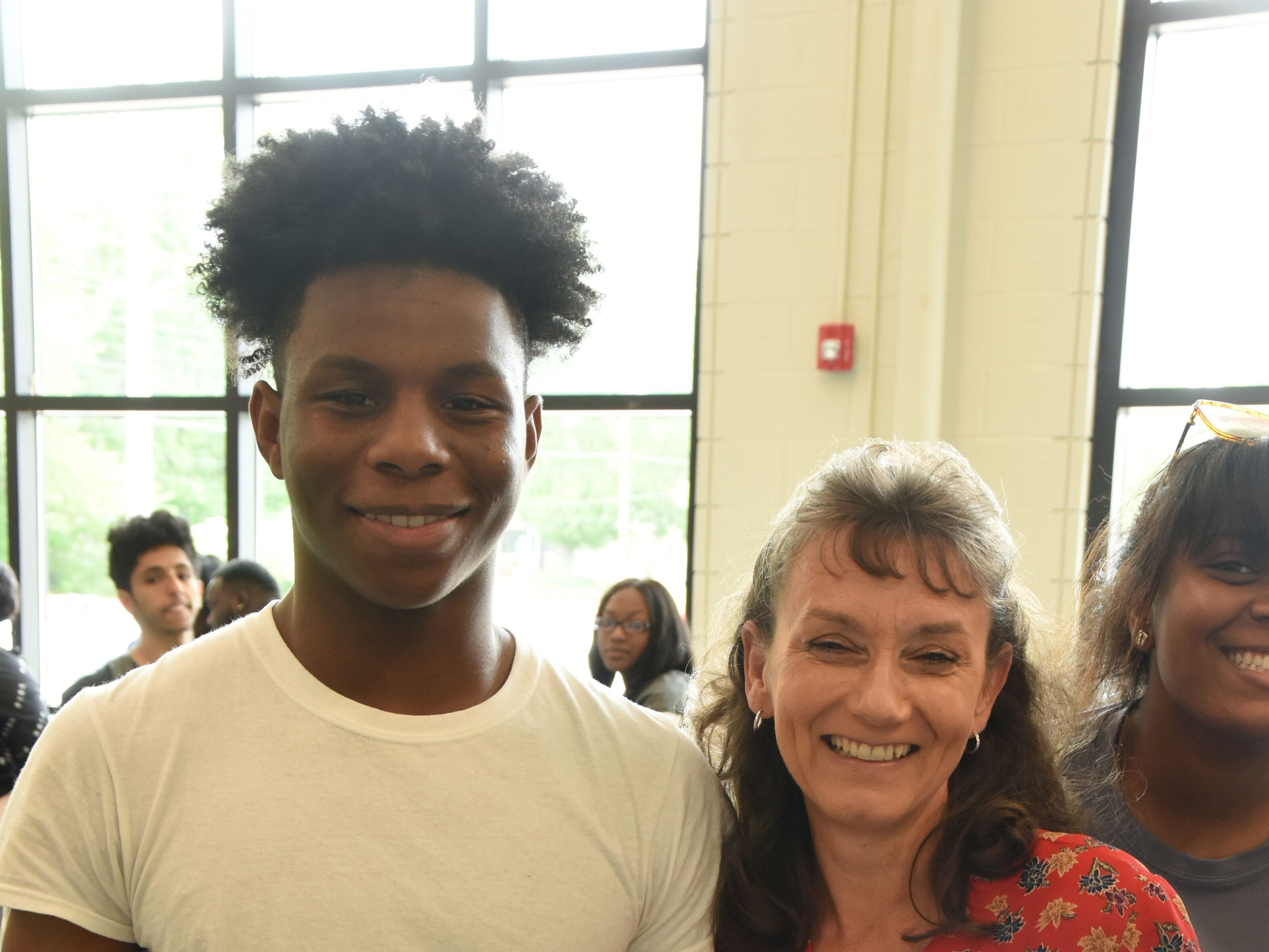 Jackson State Community College president Dr. Allana Hamilton takes a picture with Jackson-Central Merry Early College High senior and JSCC another student photo bombs.