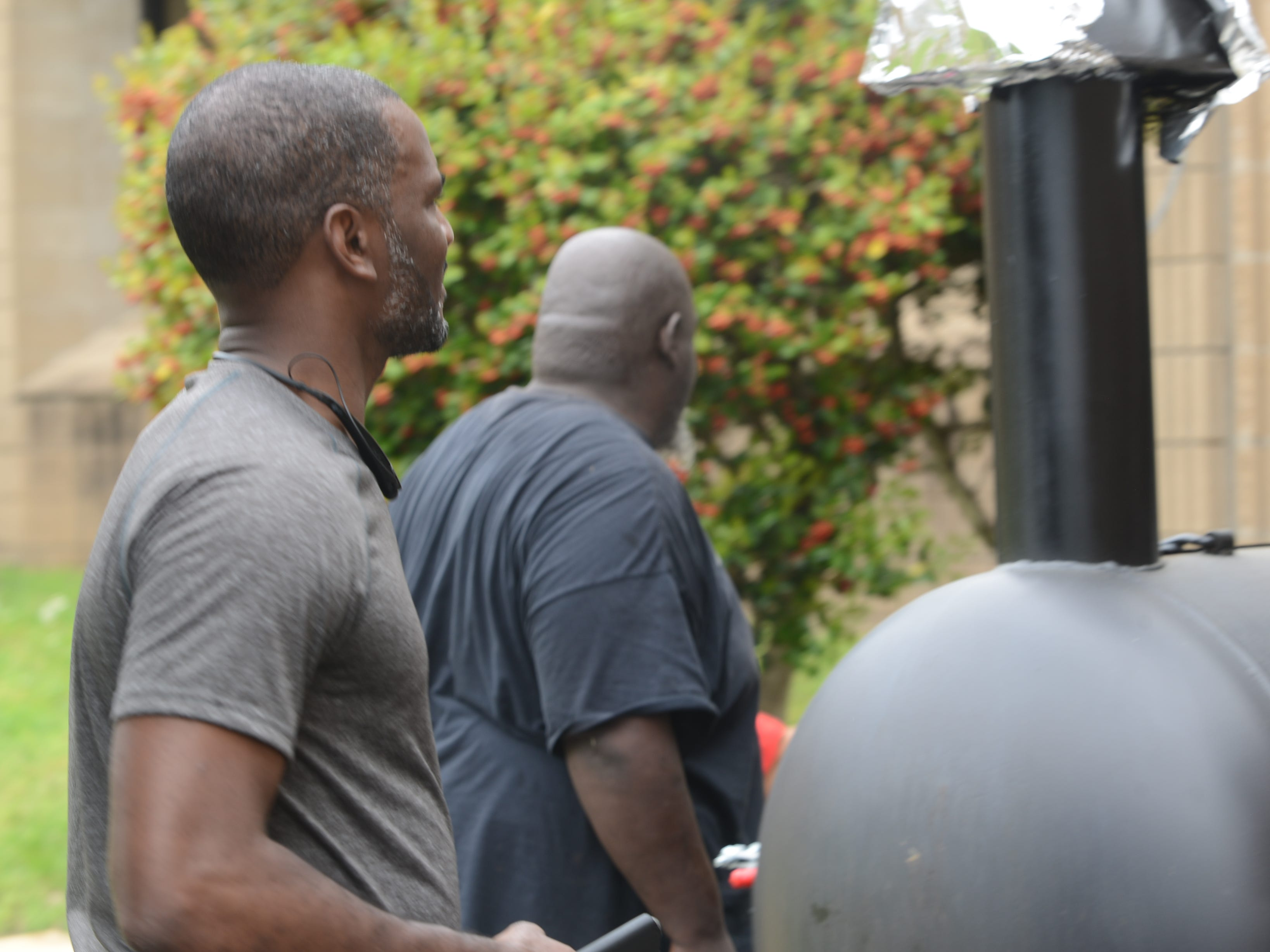 Maurice Givens and Marlo Yarbrough grilled for the senior picnic.