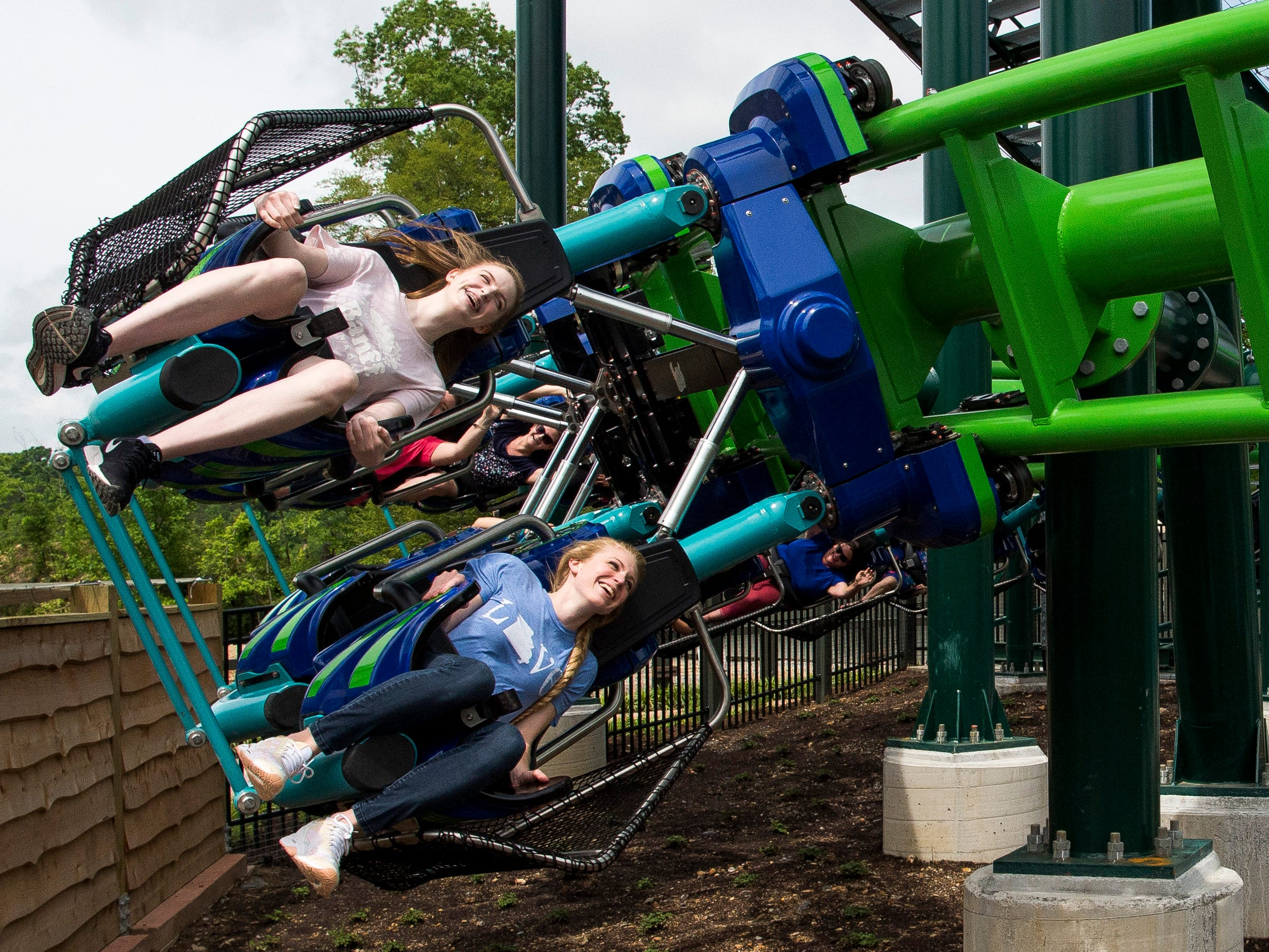 Guests enjoy The Dragonflier roller coaster during the grand opening of Dollywood's new Wildwood Grove expansion on Friday, May 10, 2019.