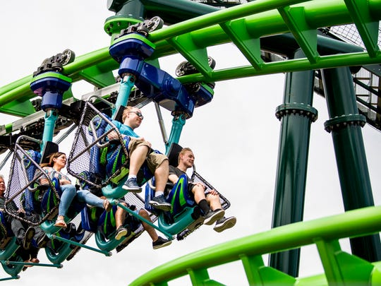 Guests ride The Dragonflier roller coaster during the grand opening of Dollywood's new Wildwood Grove expansion on Friday, May 10, 2019.