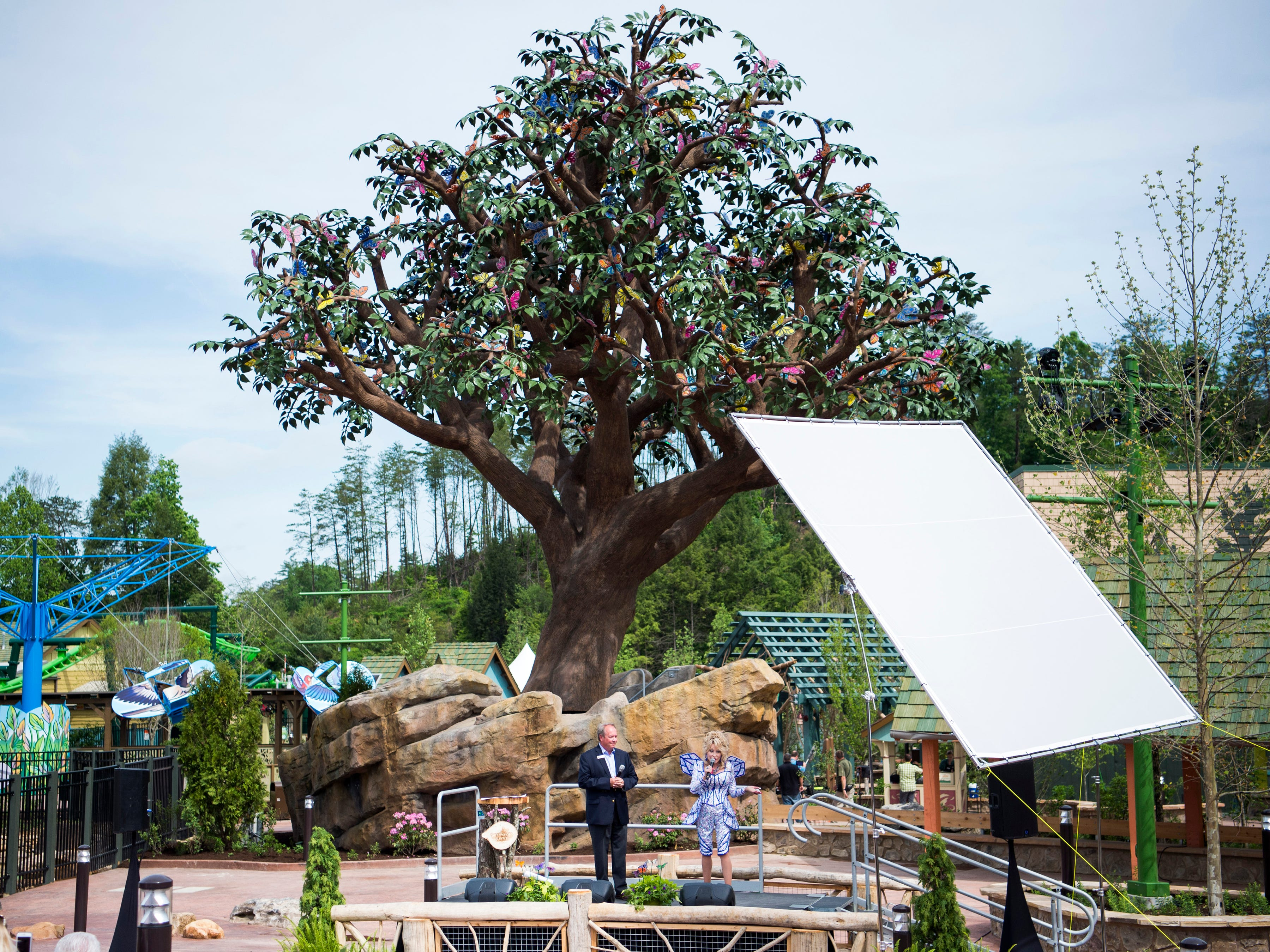 Dolly Parton speaks in front of the Wildwood Tree during the grand opening of Dollywood's new Wildwood Grove expansion on Friday, May 10, 2019.