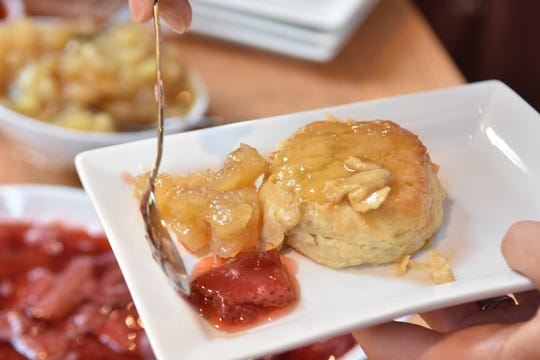 Fresh biscuits served up with butter and preserves.