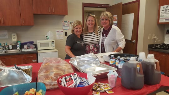 Kim Rhode, principal Sarah Brengle and Lori Montgomery say they are looking forward to Famous Dave's BBQ for lunch in honor of Teacher Appreciation Week at Ball Camp Elementary Tuesday, May 7.