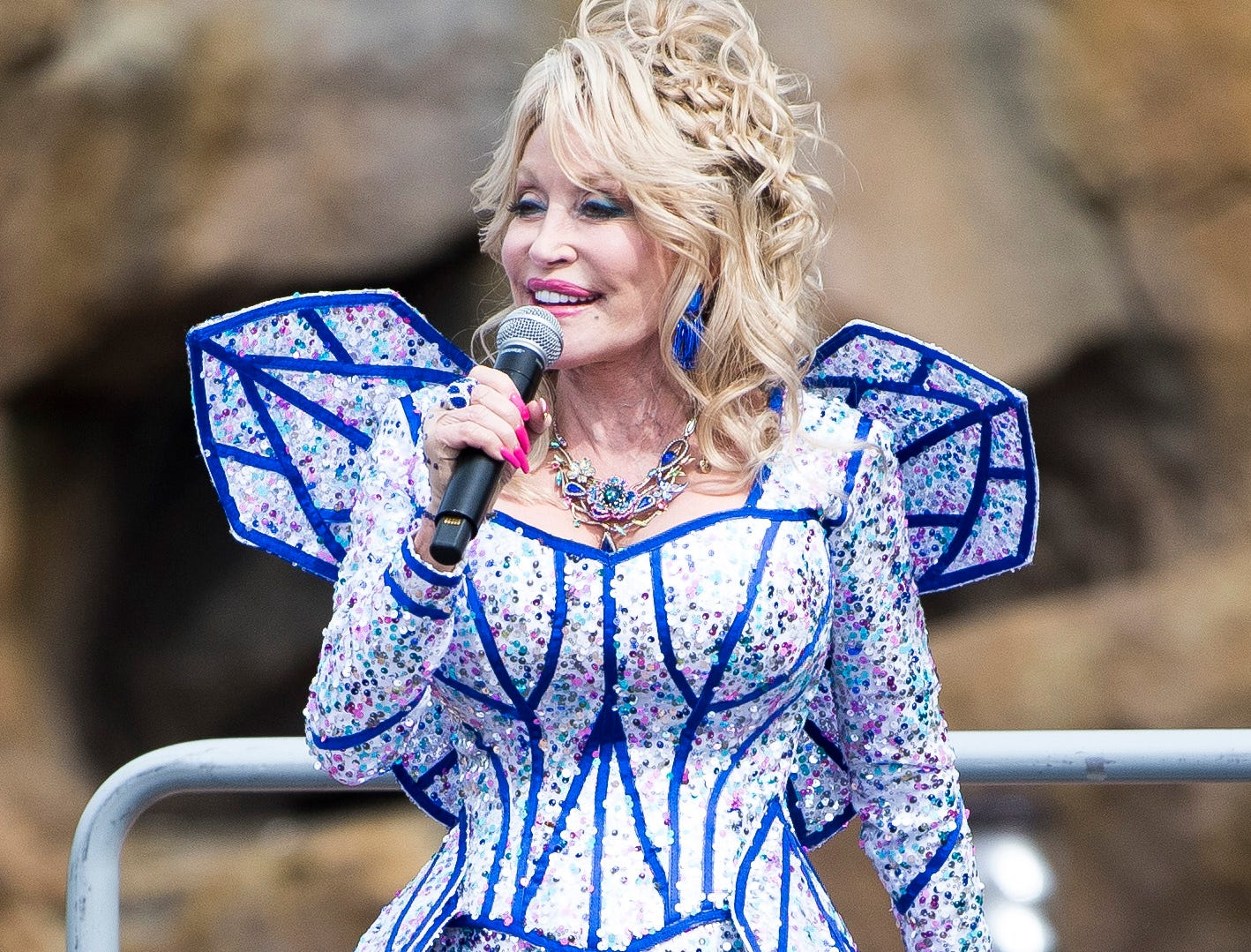 Dolly Parton speaks during the grand opening of Dollywood's new Wildwood Grove expansion on Friday, May 10, 2019.
