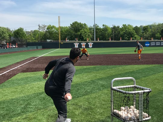 Tennessee volunteer assistant coach Ross Kivett throws ground balls to Trey Lipscomb and Andre Lipcius on April 29, 2019.