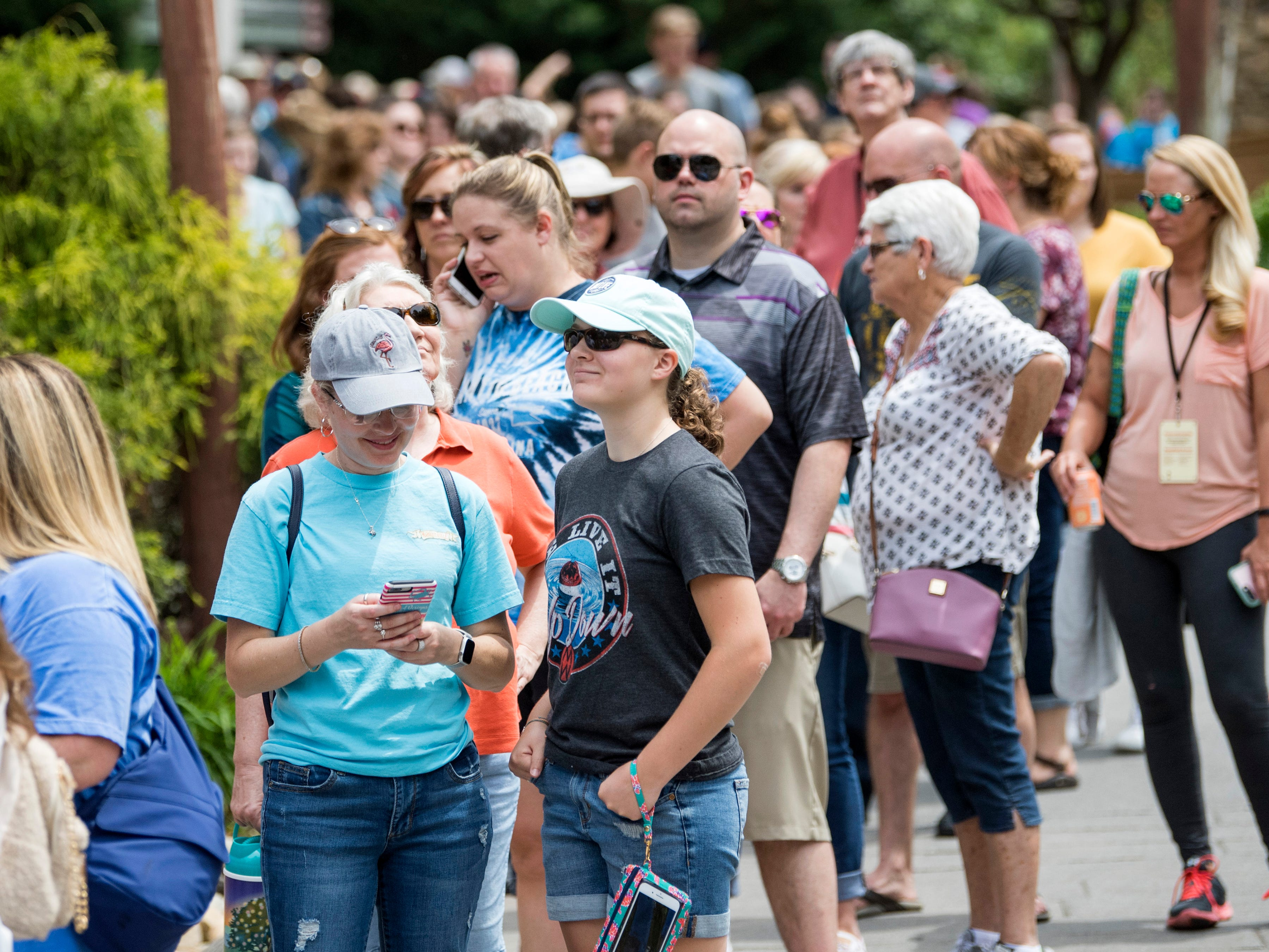 Guests wait in line to enter Dollywood's new Wildwood Grove expansion on Friday, May 10, 2019.
