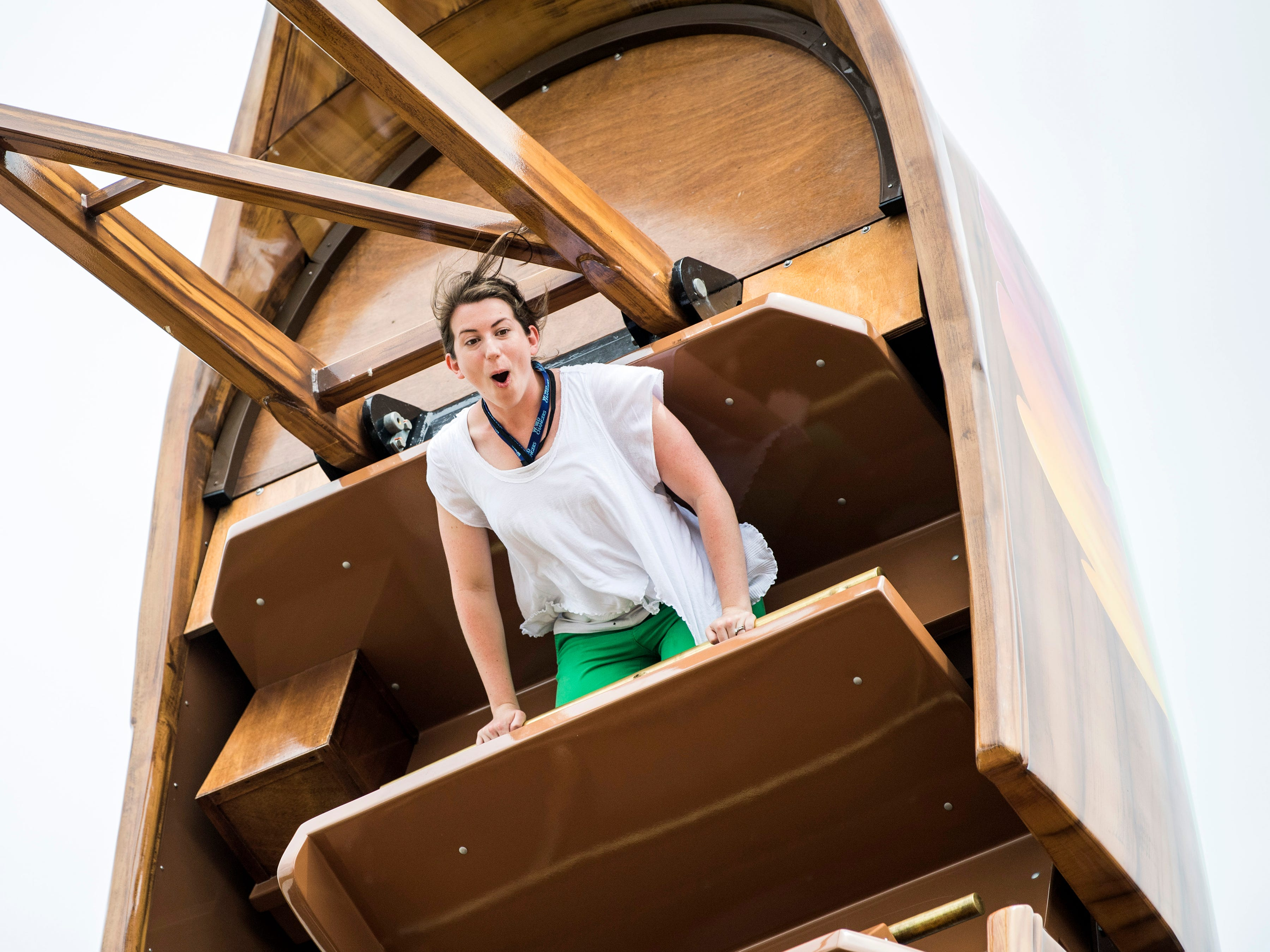 News Sentinel reporter Maggie Jones rides the Giant Tree Swing during the grand opening of Dollywood's new Wildwood Grove expansion on Friday, May 10, 2019.