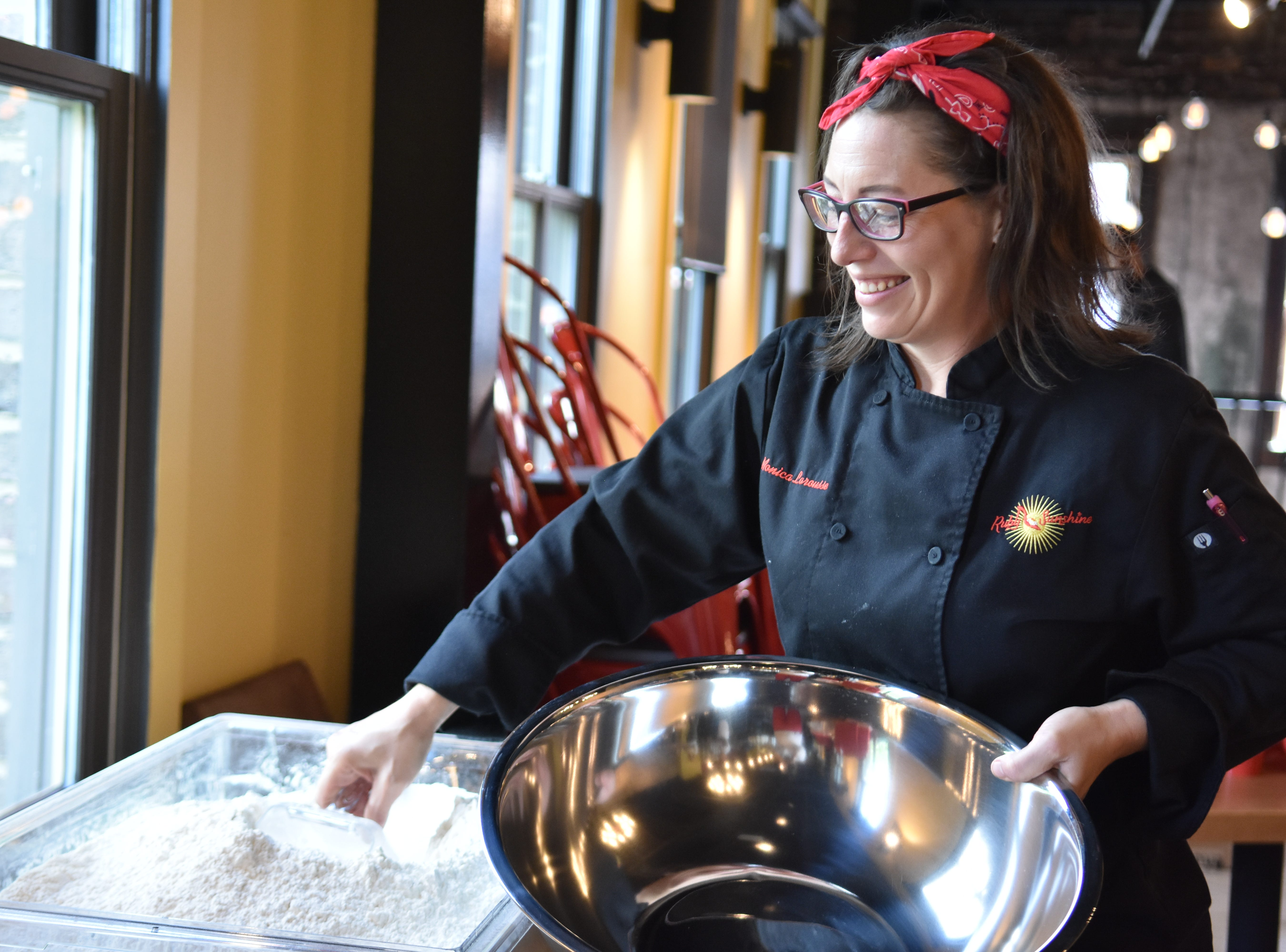 Chef Monica Larousse scoops flour in preparation for a biscuit making class at Ruby Sunshine in Market Square.