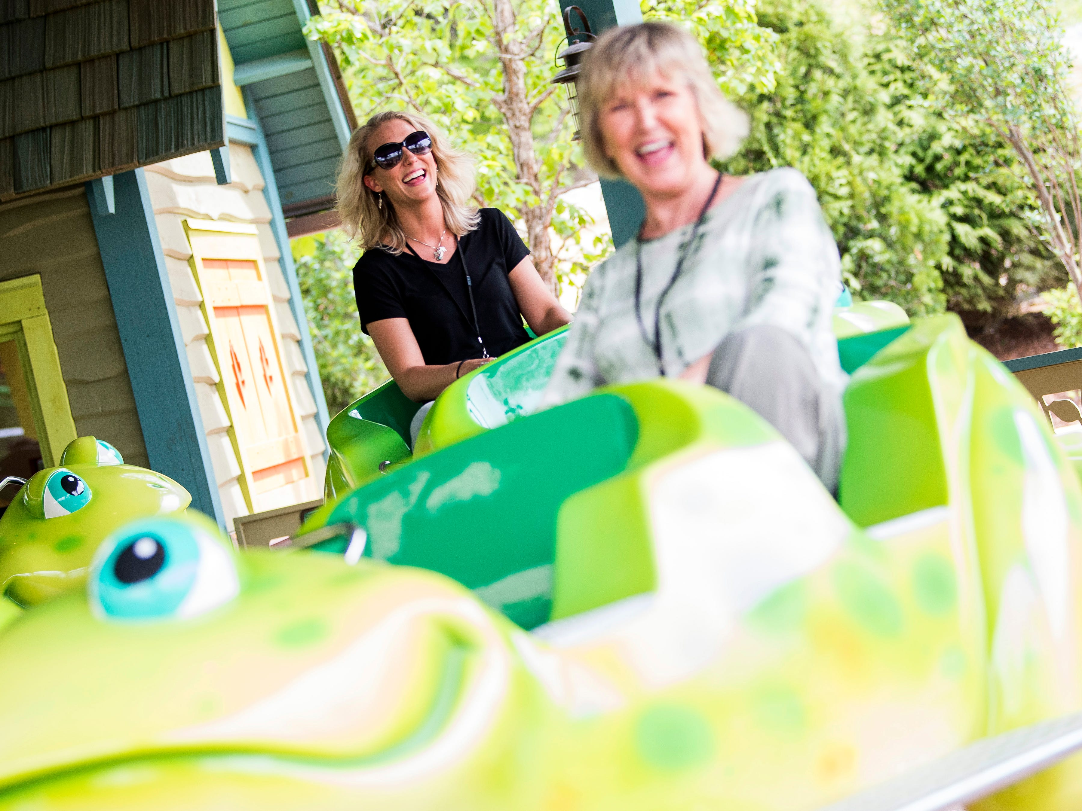 Guests ride Frogs & Fireflies during the grand opening of Dollywood's new Wildwood Grove expansion on Friday, May 10, 2019.