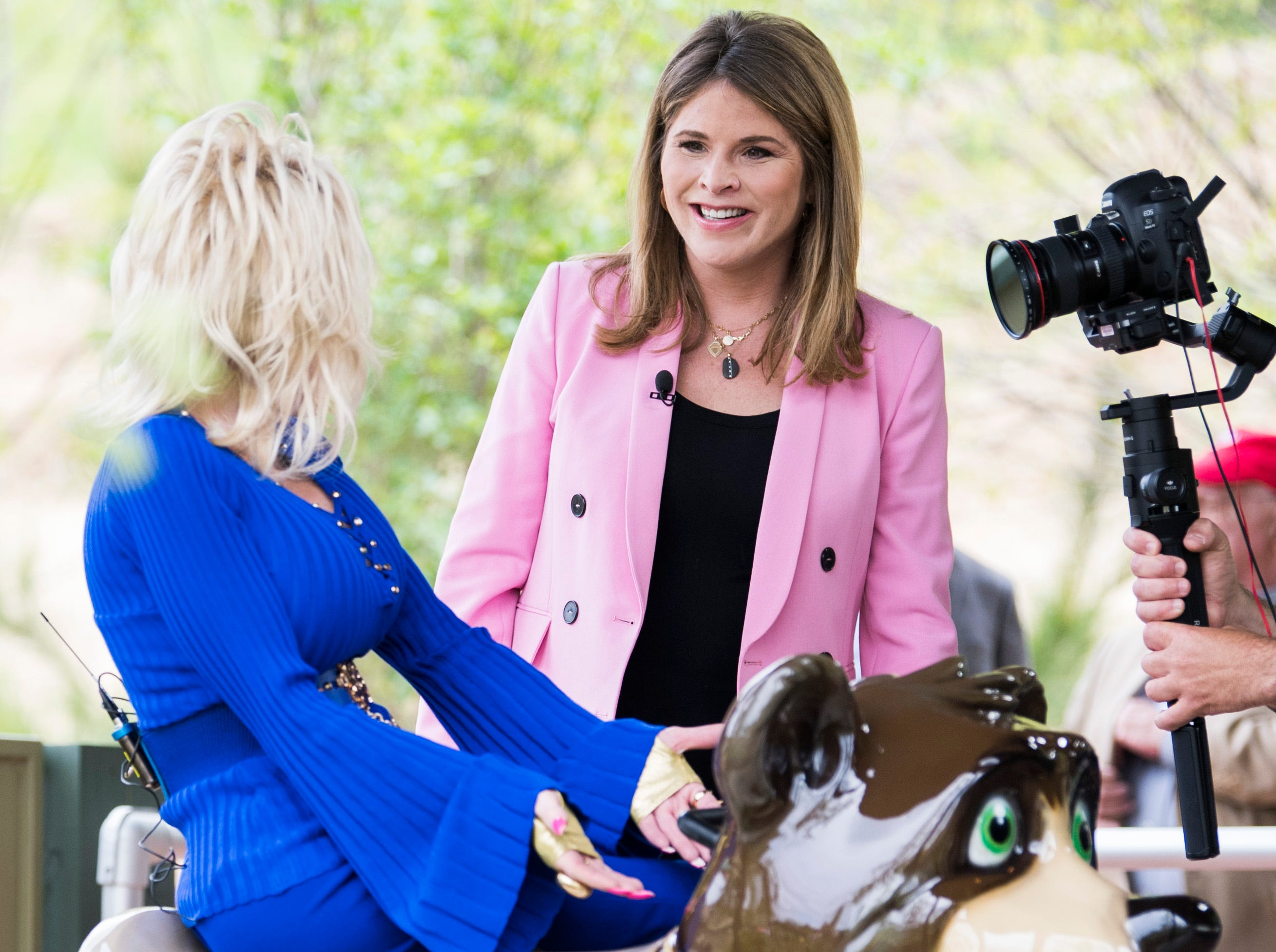 Dolly Parton sits on top of a bear at the Black Bear Trail ride with Jenna Bush Hager while filming a segment during the grand opening of Dollywood's new Wildwood Grove expansion on Friday, May 10, 2019.