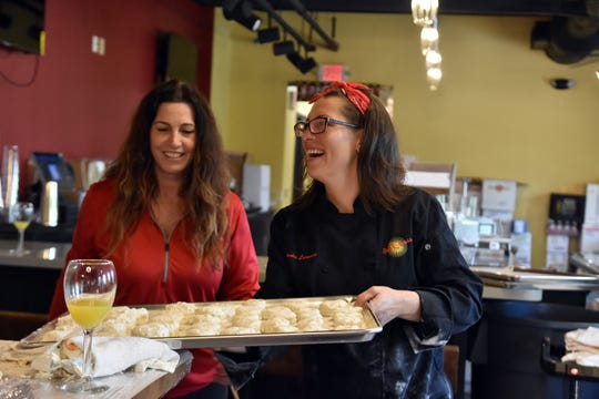 Linda Hurd and chef Monica Larousse, Ruby Sunshine culinary and beverage operations manager, get biscuits ready for the oven.
