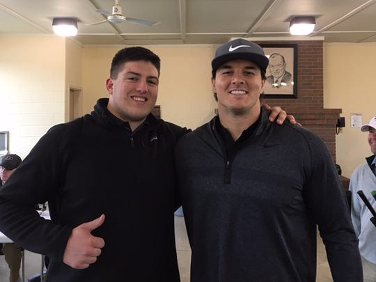 Purdue freshman George Karlaftis (L) and former Purdue defensive end and current Washington outside linebacker Ryan Kerrigan