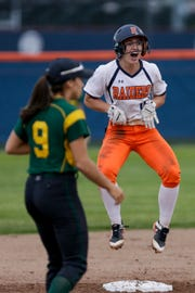 Harrison catcher Kiley Goff (11) celebrates after stealing second during the first inning of a high school softball game, Thursday, May 9, 2019, at Harrison High School in West Lafayette. Harrison won, 6-5.