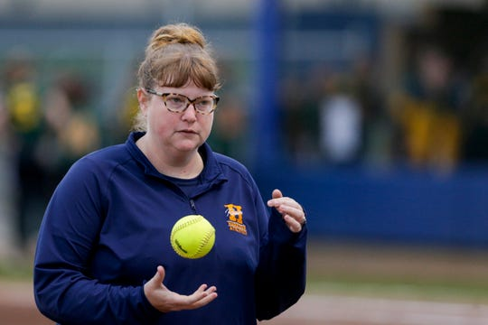 Harrison head coach Brooke El Othmani juggles a ball during the fifth inning of a high school softball game, Thursday, May 9, 2019, at Harrison High School in West Lafayette. Harrison won, 6-5.