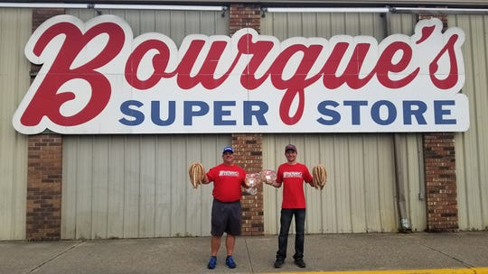 President of Bourque's Supermarket Shannon Bourque (left) and Vice President Chad Bourque (right) stand in front of the Bourque's Super Store in Port Barre.
