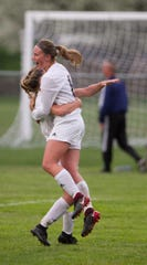 Hartland's Caitlyn Trombley, right, celebrates with Lauren Way after scoring the first goal in a 3-0 victory at Brighton on Thursday, May 9, 2019.